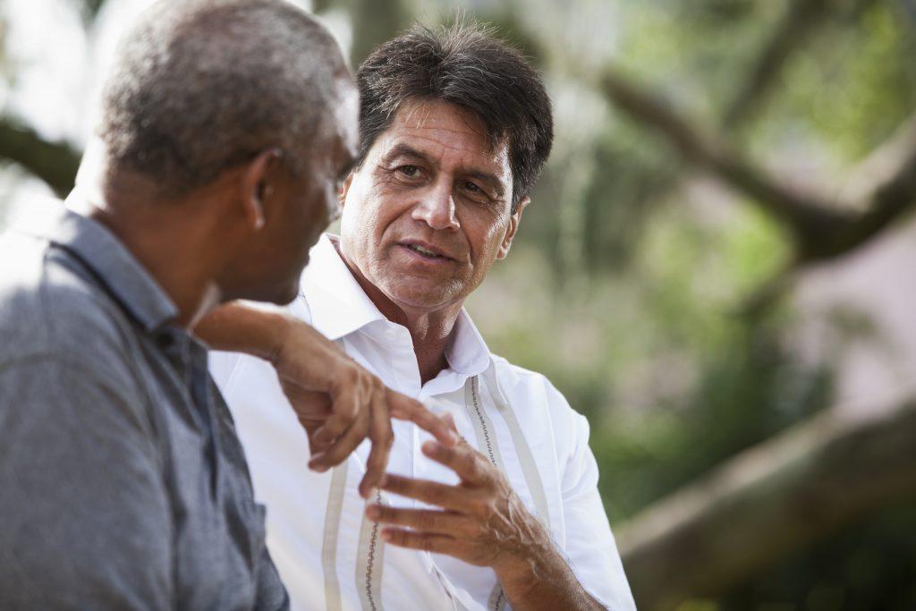 two men having a conversation outdoors