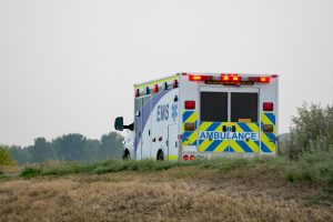 Ambulance EMS on rural road with warning lights